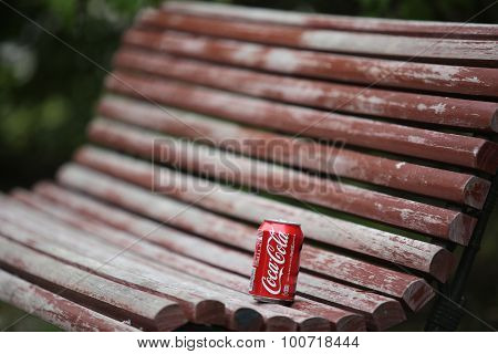 Coca-cola On The Bench In The Park