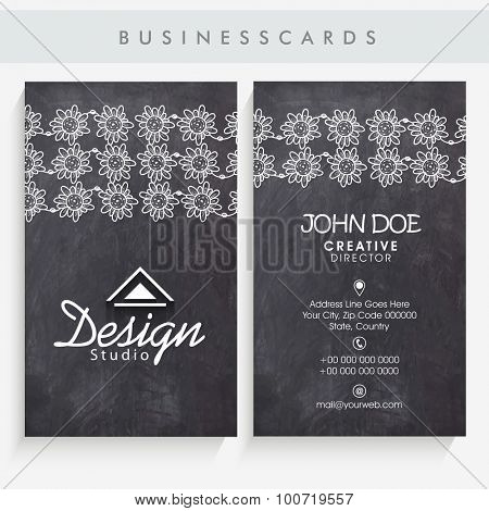 Beautiful vertical business card, name card or visiting card set with floral abstract on black vintage background.