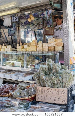 Wild Oregano And Cheese From Sicily In A Market Stall.