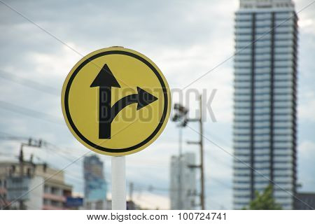 Sign Turn Right Or Go Straight With Skyscraper