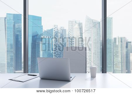 A Workplace In A Modern Panoramic Office With Singapore View. A White Table, White Leather Chair. La
