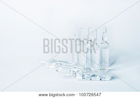 Break-seal Glass Ampoule Set With Liquid Medicine On Light Blue Background.