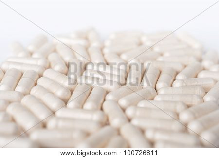 Spilled White Capsules On The White Background