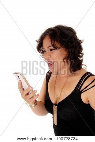 Young Woman Shouting At Her Cell Phone.