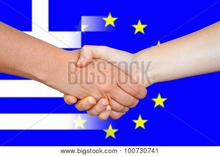 EU and Greece flags with a handshake