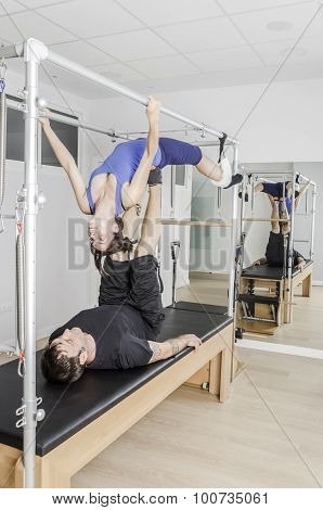Couple Doing Pilates In Cadillac.