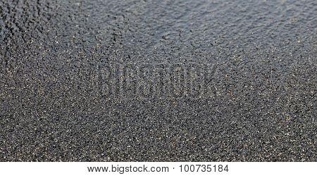 Moist Black Beach Sand