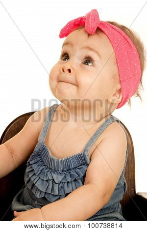 Adorable Baby Girl Looking Up Wearing A Pink Headband