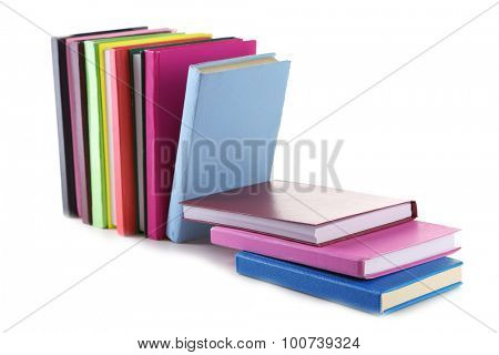 Falling books isolated on white