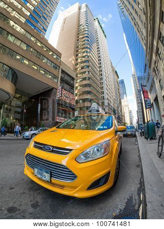 NEW YORK,USA - AUGUST 13,2015: An iconic yellow cab parked in Broadway in downtown Manhattan