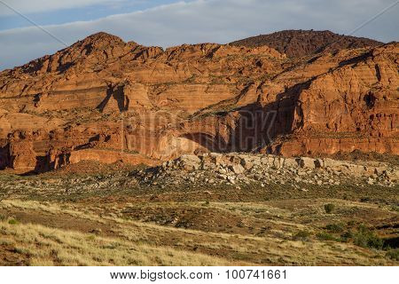 Sunrise On A Rock Arch In A Red Rock Mountain