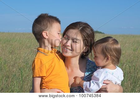 Mother With Son And Daughter, Boy Kissing Mum