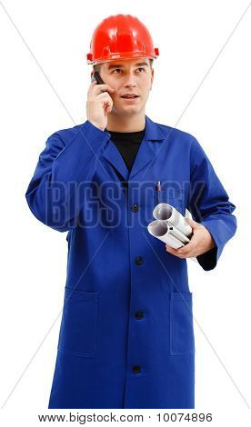 Young Engineer With Projects And Telephone