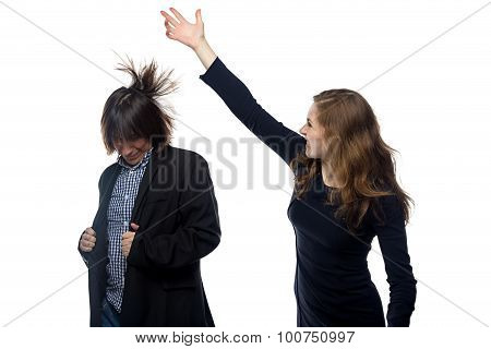 Woman beating young man