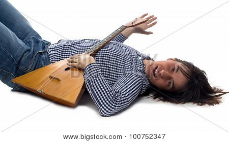 Lying brunette man with balalaika