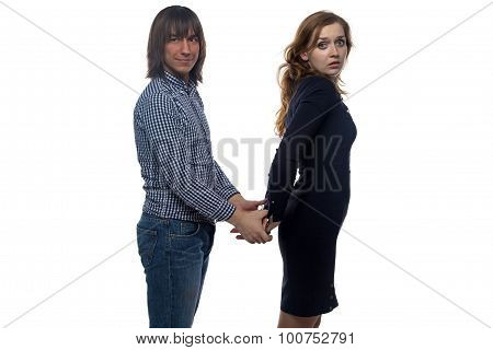 Brunette man and woman with pair of handcuffs