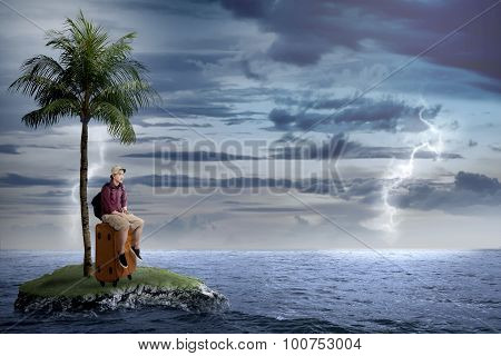 Asian Tourist Sit On The Suitcase On The Small Island