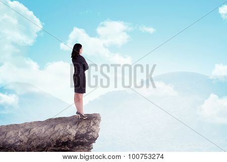 Asian Business Woman Standing On Top Of The Mountain