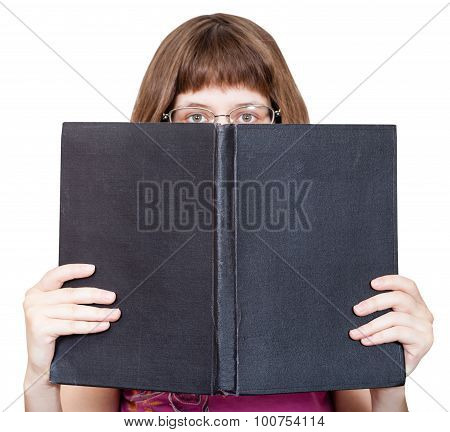 Front View Of Girl With Spectacles Looks Over Book
