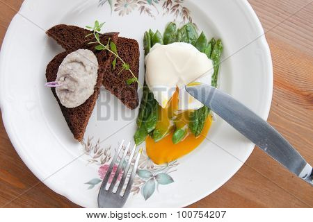 broken poached eggs on the greens