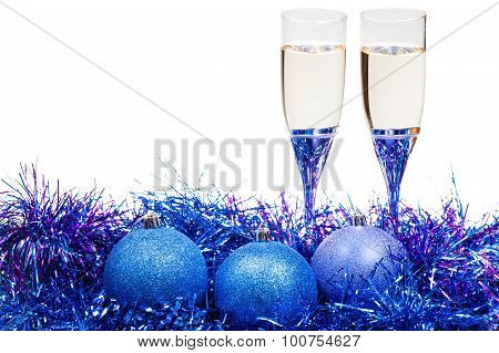 Glasses Of Champagne And Blue And Violet Baubles