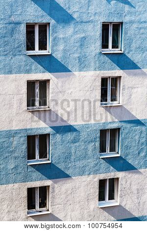 Wall Of Urban House With Windows