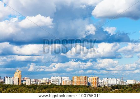Low Clouds Over Woods And Apartment Buildings