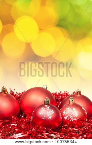 Xmas Red Bauble On Blurred Yellow Green Background