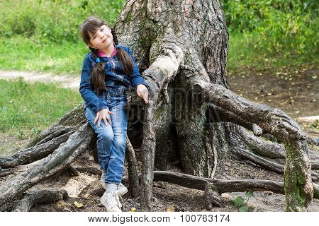 The Little Girl Sat Down To Rest On The Roots Of A Tree