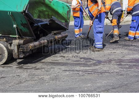 Workers On Asphalting Road