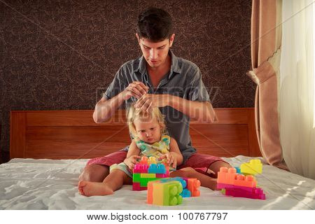 Girl Plays Toy Constructor Father Brushes Her Hair