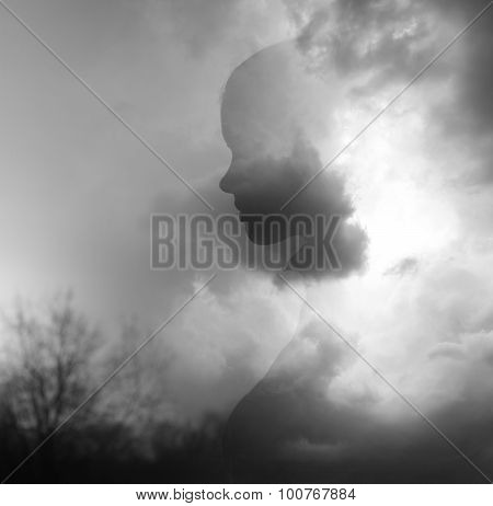 Double Exposure Image Made Of Silhouette Of Young Girl Emerging From Sunny Summer Clouds