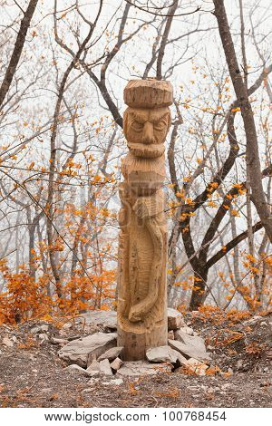 Pagan idol in autumn forest