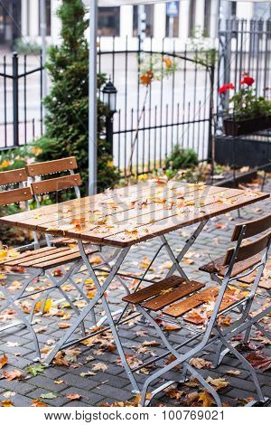 Empty Outdoor Cafe Table On The Rainy Day