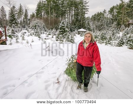 Woman Cuts A Christmas Tree