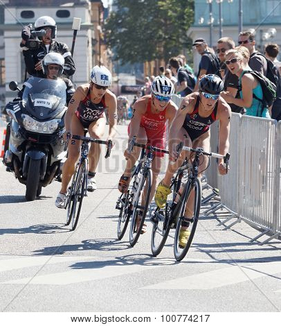 Triathlete Katie Zaferes Cycling, Followed By Competitors
