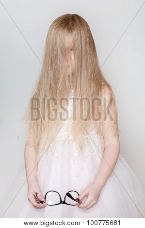 Little Girl With Long Hair Covered Her Face
