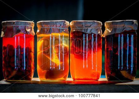 Four Cans Of Compote Fruit And Berries Illuminated