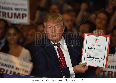 Donald Trump holds signed pledge