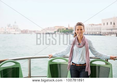 Happy Woman Tourist Relaxing On A Boat In Venice