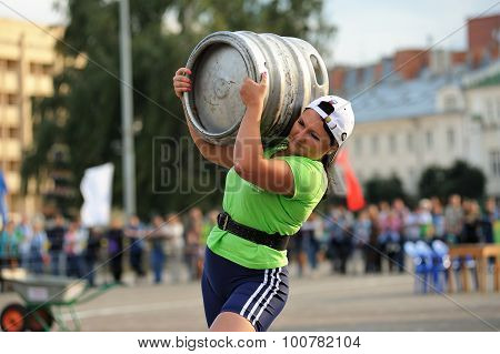 Orel, Russia, September 5, 2015: Woman Carrying Heavy Metal Keg In Competition