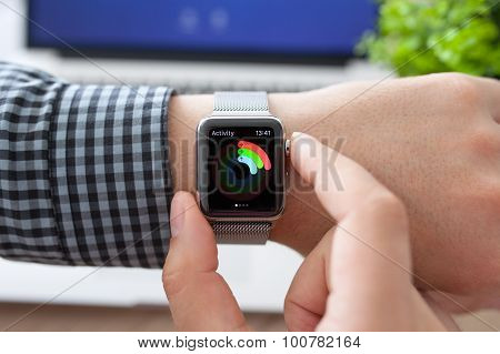 Man Hand In Apple Watch With Activity And Macbook