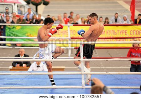Orel, Russia, September 5, 2015: Male Kickboxers Fighting On The Ring