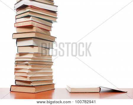 High Books Stack On White Background