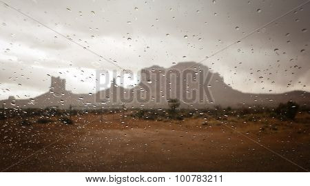 Monument Valley seen through window with raindrops, Monument Valley Tribal Park, Navajo, Mesa, Mesa