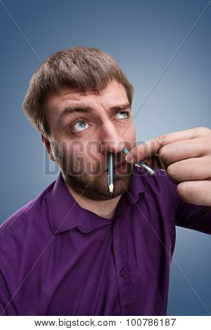 Man with pencil in the nose
