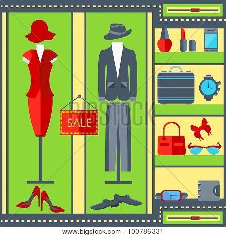 Shop window mens womens clothing suits, dresses, watches, handbags