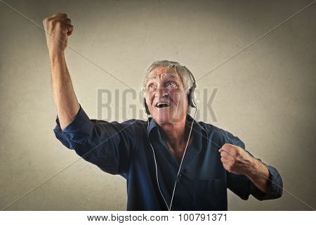 Elderly man listening to music