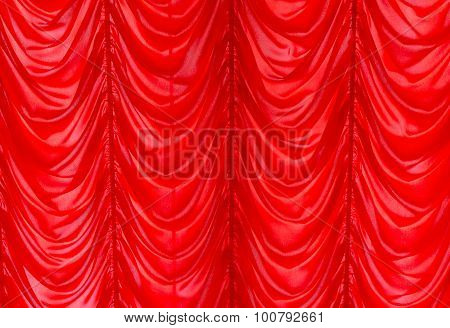 Bright Red window shade deaped in folds