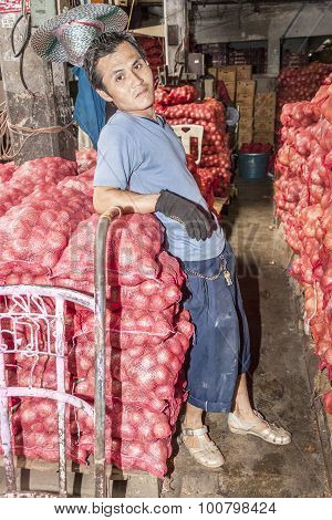 Unidentified  Man Transports Sacks Of Onions I